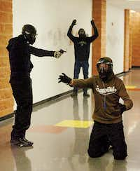 The joint tactical training for the three Lake Cities departments included scenarios where hostages were taken. Officers trained with 9 mm Glocks and AR-15s loaded with Simunition rounds.Al Key - DRC