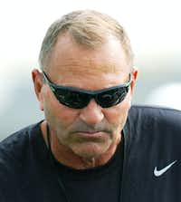 University of North Texas head coach Dan McCarney talks to players during a break at spring football practice, Wednesday, March 28, 2012, at the Darrell R. Dickey Practice Facility in Denton, Texas.David Minton