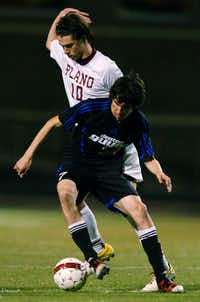 Plano senior midfielder Mitchell Day (10) grabs onto Guyer senior forward Edgar Jimenez (7), Wednesday, April 4, 2012, at Tommy Briggs Cougar Stadium in The Colony, Texas.David Minton