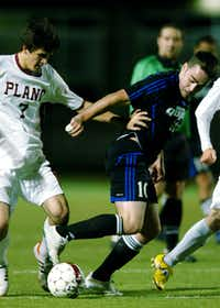 Guyer senior midfielder Harrison Gorman (10) and Plano senior defender Brandon Wodka (7) tangle going for the ball, Wednesday, April 4, 2012, at Tommy Briggs Cougar Stadium in The Colony, Texas.David Minton