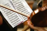 Sheet music is shown in detail Tuesday as members of the Odysseus Chamber Orchestra practice.David Minton