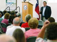 U.S. Rep. Michael Burgess, R-Lewisville, speaks at a town hall-style meeting Wednesday at the Center for the Visual Arts in Denton.David Minton
