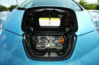 The electrical charging port in the front of a Nissan Leaf at Orr Nissan, Saturday, July 14, 2012, in Corinth, TX.David Minton