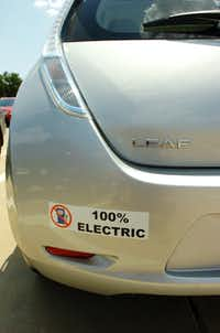 John Gauthier had this bumper sticker custom made for his 2011 Nissan Leaf because people kept asking him how often he filled up with gas, Saturday, July 14, 2012, in Corinth, TX.David Minton