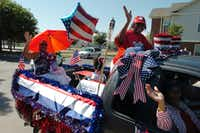 A patriotic display heads through Southeast Denton during the Fred Moore High School reunion parade Saturday.David Minton