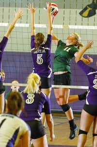 Calvary's Cory Grant (11) knocks one over as Denton sophomore Hannah Altman (5) tries to block, Tuesday, August 14, 2012, in Denton, TX.David Minton
