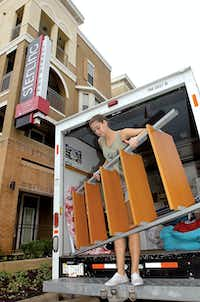 UNT sophomore Camilla Smith moves her belongings in to her new apartment at Sterling Fry Street during move-in day Wednesday August 15, 2012, in Denton.Al Key