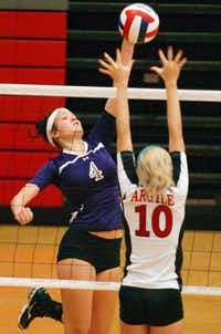 Denton's Gennifer Holberg (4) hits as Argyle's Brooke Robertson (10) tries to block, Tuesday, August 21, 2012, in Argyle, TX.David Minton