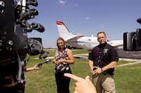 Denton County emergency services spokesman Jamie Moore, right, and Laura McGowan of Clarke/Dynamic Aviation answer questions about aerial spraying ThursdayAl Key