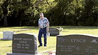Buddy Dobson walks through the Green Valley Cemetery on Friday.DRC/Al Key
