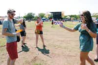 A squirt gun fight breaks out at Saturday's Hot Wet Mess at the North Texas State Fairgrounds in Denton.DRC/David Minton