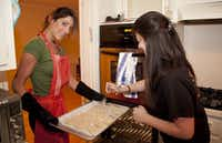 University of North Texas students Shahaf Bareni, left, and Shani Ashkenazy prepare to bake gefilte fish Thursday at Chabad North Texas, Rabbi Levi and Leah Dubrawsky's home in Denton.For the DRC/Maegan Puetz