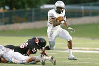 Guyer senior running back Richard Whitaker (36) powers past Colleyville Heritage senior safety Myles Crosby (36), Thursday, September 6, 2012, at Dragon Stadium in Southlake,David Minton