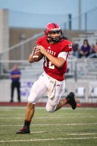 Aubrey senior quarterback, Mason Robinson (12) looks to complete a pass during the first quarter against the Anna Coyotes at Chaparral Stadium on September 6, 2013.Maegan Puetz