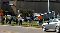 Protestors set up along McKinney St in front of Denton City Hall before a city council meeting where the drilling moratorium in Denton in expected to be extended until December. However, drilling permit applicationsfor several wells that were filed before the moratorium went in to effect, are likely to be approved., Tuesday, September 11, 2012, in Denton, TX.David Minton
