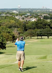 Member Ron Carlock hits off the fifth tee at the Denton Country Club golf course Thursday in Denton.Al Key