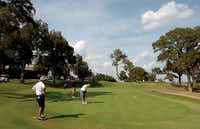 Denton Country Club members finish up a round of golf on the 18th green Thursday September 27, 2012, in Denton.Al Key