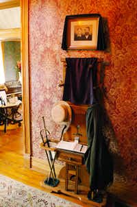 """As a sign of mourning, mirrors have been covered and photos draped with black cloth throughout the Bayless-Selby House as part of an exhibition called """"Death and Dying in Victorian Times"""" and the house has been transformed to recreate a Victorian era at-home funeral, Friday, September 28, 2012, in Denton, TX.David Minton"""