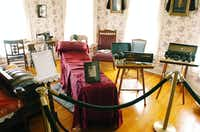 """An upstairs bedroom at the Bayless-Selby House Museum serves as an area for embalming Friday as part of an exhibition called """"Death and Dying in Victorian Times."""" The house has been transformed to re-create a Victorian-era at-home funeral.David Minton"""