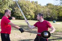 Association for Renaissance Martial Arts members Curtis Rochelle, left, and Ben Morgan perform a sword grab Sunday at South Lakes Park in Denton. The local group practices techniques in the art of fencing and in the use of the long sword.Jeff Woo - DRC