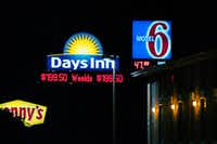 Hotels along I-35 near U.S. Highway 380 display their room rates for travelers in Denton.David Minton/DRC