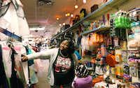Jessica Houston and her 3-year-old daughter, Jamyla, search through Halloween decorations and costumes at PJ's Party Supplies in Denton.David Minton/DRC