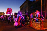 Marchers in the Day of the Dead Festival's twilight costume parade head back down Hickory Street on Saturday evening.DRC/David Minton