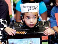 "Julius Barron illustrates his phrase ""rectangular prism"" by wearing amicrowave costume during the Vocabulary Parade at Rivera Elementary School on Wednesday.Al Key"