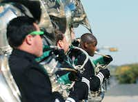 Sousaphone players in UNT's Green Brigade perform as the parade makes its way around the Square.DRC/David Minton