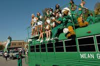 The UNT cheerleaders and Scrappy ride in the University of North Texas homecoming parade on Saturday in Denton.DRC/David Minton