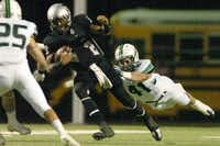 Guyer sophomor equarterback Jerrod Heard (2) runs up the middle on a keeper as Southlake Carroll senior linebacker Nash Neu (41) leaps to bring him down, Friday, November 4, 2011, at C.H. Collins Athletic Complex in Denton, Texas.David Minton