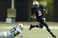 Guyer sophomore quarterback Jerrod Heard (2) scrambles out of the backfield avoiding a tackle by Southlake Carroll senior defensive back Nick Melocik (27), Friday, November 4, 2011, at C.H. Collins Athletic Complex in Denton, Texas.David Minton
