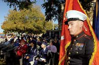 Marine corporal Patrick Fernandez holds the Marine flag during the Veterans Day program at the Courthouse-on-the-Square Monday November 12, 2012, in Denton.Al Key - DRC