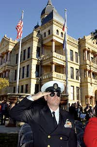 Retired US Navy chief petty officer Donald Phillips salutes during the pledge of allegiance at the Veterans Day program at the Courthouse-on-the-Square Monday November 12, 2012, in Denton.Al Key - DRC