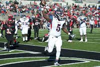 Ryan's J.T. Williams celebrates after scoring a touchdown against Cedar Hill on Saturday in Southlake.Chronicle