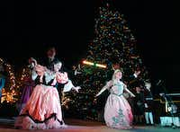The Festival Ballet of North Central Texas performs A Gift for Emma, a locally produced companion piece to The Nutcracker in front of the tree at the Denton Holiday Lighting Festival on Friday.David Minton - DRC