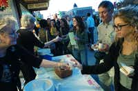 People line up for wassail and cookies from the Courthouse Collection at the Denton Holiday Lighting Festival on Friday.David Minton - DRC