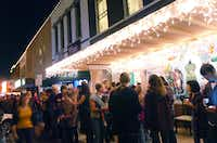 People wait in line for wassail outside businesses on the Square at the 2012 Denton Holiday Lighting Festival on Friday.David Minton - DRC