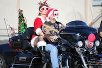 A few riders took inspiration from Santa and Mrs. Claus for the Coats for Kids Ride on Sunday.Christian McPhate - DRC