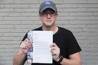 Brady Cunningham holds his letter of acceptance to the University of Texas at Arlington on Wednesday at his house near East Sherman Drive and Edinburg Lane in Denton.Jeff Woo