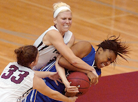 The Pioneers' Rachel Schlosser (23) and Barbara-Scott Kolb (33)  fight for possession of the ball with the Rattlers' Bria Bell (42) during their game at Kitty Magee Arena Wednesday December 5, 2012, in Denton.Al Key - DRC