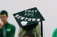 During the University of North Texas' fall commencement ceremonies Saturday, a student's graduation cap memorializes Friday's shootings at Sandy Hook Elementary School in Newtown, Conn.DRC - David Minton