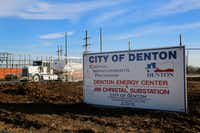 Trucks move in and out of the Denton Energy Center site, where a new power plant is under construction on the city's west side.Tomas Gonzalez  - DRC