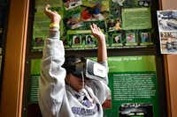 Sanger ISD student Wendy Rivas uses a virtual reality headset during a learning camp Saturday at UNT's Discovery Park.Jeff Woo