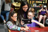Destiny Horne, left, Bethany Ramirez and Brooklyn Cosgrove test an augmented reality app during a half-day NASA learning camp on Saturday at UNT's Discovery Park.Jeff Woo
