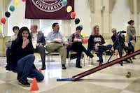 Judges laugh as a team's entry falls off the racetrack during TWU's Edible Car Contest on Friday.Tomas Gonzalez
