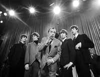 "LEFT:  The Beatles' landmark 1964 appearance on ""The Ed Sullivan Show"" is, naturally, part of ""The Best of the Ed Sullivan Show."" Sullivan, center, stands with, from left, Ringo Starr, George Harrison, John Lennon and Paul McCartney, during a rehearsal.Anonymous"