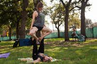 """Karen Starnes  and Jon Overton perform a calibrating move called the """"throne"""" during an AcroYoga session Sunday at UNT.Jeff Woo  - DRC"""