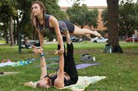 "Karen Starnes   and Jon Overton perform a calibrating move called ""the bird"" during an AcroYoga meetup Sunday outside UNT's Clark Hall. In AcroYoga, two people work together to achieve a goal. ""Calibrating"" helps individuals get used to each others' weight.Jeff Woo - DRC"