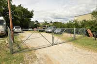 Recently towed vehicles are shown in this fenced off area in the back of the Akers Towing lot on Dallas Drive on Friday in Denton.David Minton - DRC